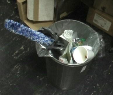 saxophone swab in the trash